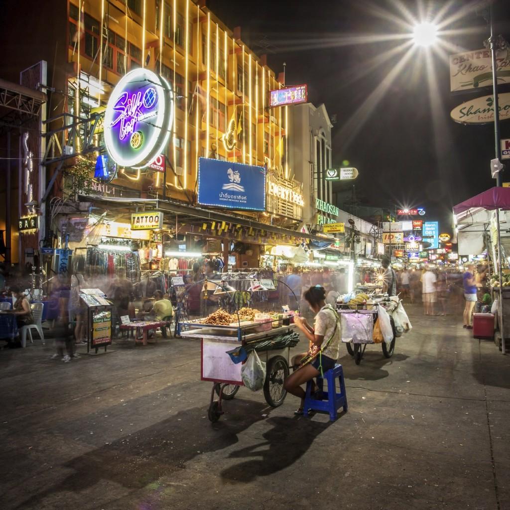 BANGKOK - APRIL 21, 2014: Street food vendor and tourist shops o