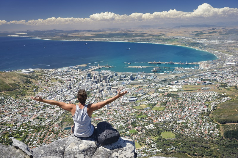 Tourist Hiker on Table Mountain overlooking Cape Town, South Africa